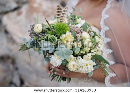 Bride with wedding bouquet in hand
