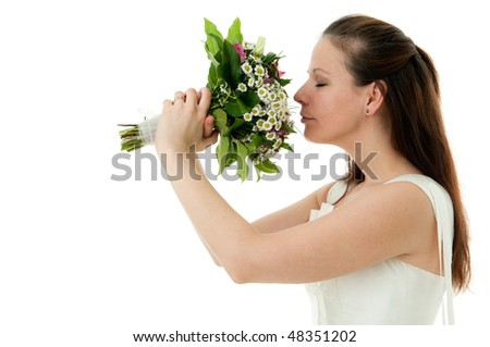 Bride with wedding bouquet on the white background