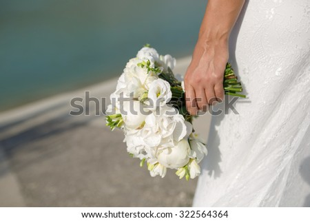bride with wedding bouquet peony flowers