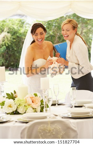 Bride With Wedding Planner In Marquee - stock photo