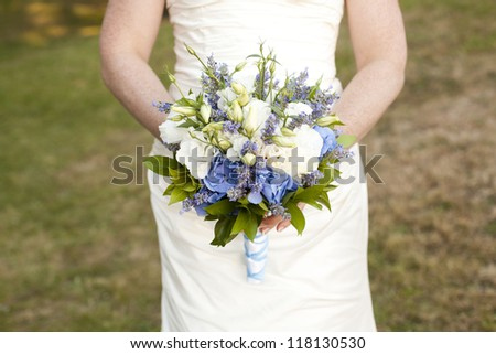 bride with wildflower  bouquet - stock photo