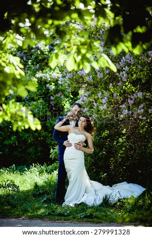 Bridegroom and bride in the spring forest