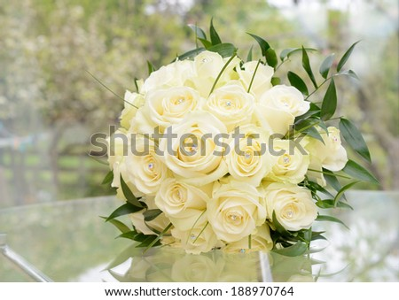 Brides bouquet of beautiful yellow roses on wedding day - stock photo