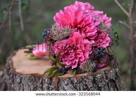 Brides bouquet of dahlias and vines. - stock photo