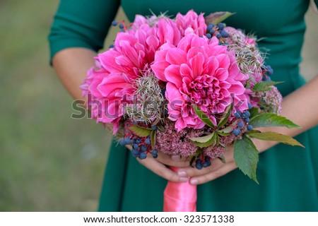 Brides bouquet of dahlias and vines. Bridesmaid Holding Bouquet - stock photo