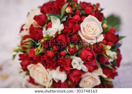 Brides bouquet of red and white roses