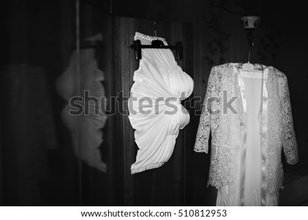 Brides dress for wedding ceremony at home