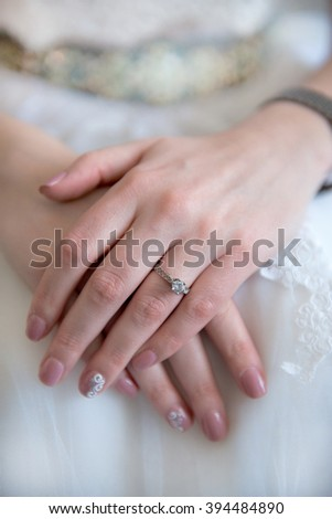 Brides hands and ring - stock photo