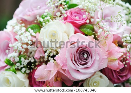 Brides pink and white roses on wedding day