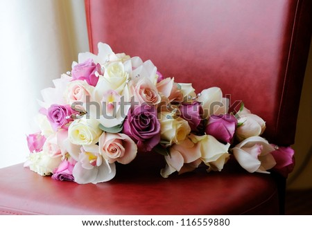 Brides purple and pink roses and orchid - stock photo