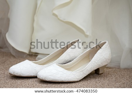 brides shoes at bottom of dress