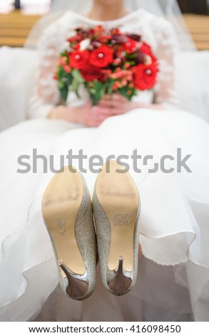 Brides shoes - the bottom of a brides shoes read I Do. - stock photo