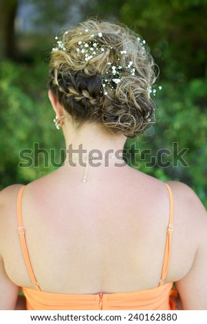 Bridesmaid hairstyle. - stock photo