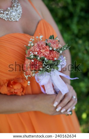 Bridesmaid holding a bouquet. - stock photo