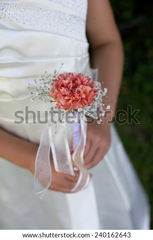 Bridesmaid holding a bouquet.