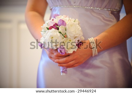 Bridesmaid holding bouquet - stock photo