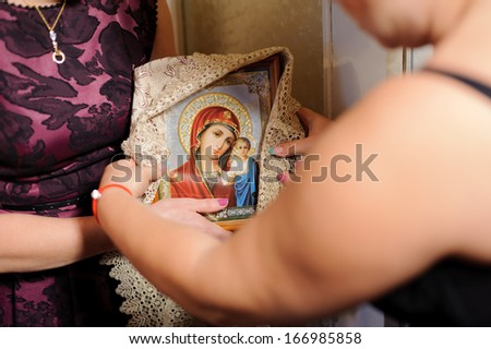 bridesmaid holding icon for church ceremony - stock photo