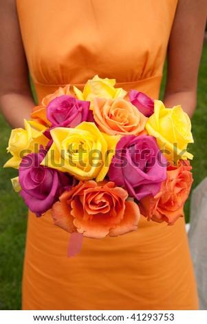 Bridesmaid holding wedding bouquet - stock photo