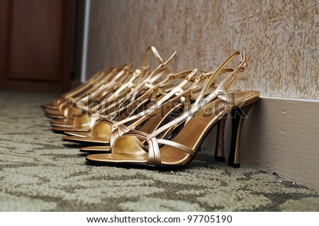 Bridesmaid's shoes lined up before a wedding - stock photo