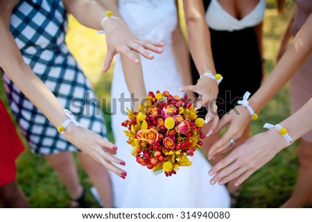 bridesmaids are drawn to flowers
