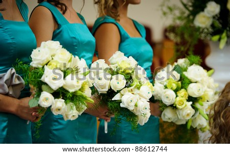 Bridesmaids holding flowers - stock photo