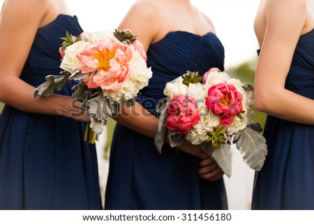 Bridesmaids in Blue with Beautifully Arranged Bouquets - stock photo