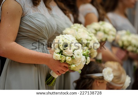 Bridesmaids with flowers - stock photo