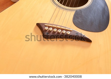 bridge acoustic guitars. six strings for background