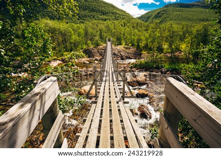 Bridge Across Norway Mountain River. Sunny Summer Day - stock photo