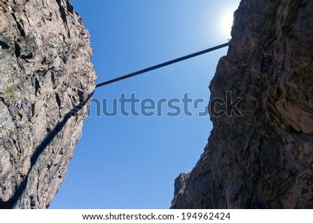 Bridge across rocky canyon in Colorado, USA - stock photo