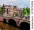 Bridge along the canals of Amsterdam, Netherlands - stock photo