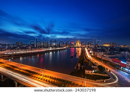 bridge and city at night - stock photo