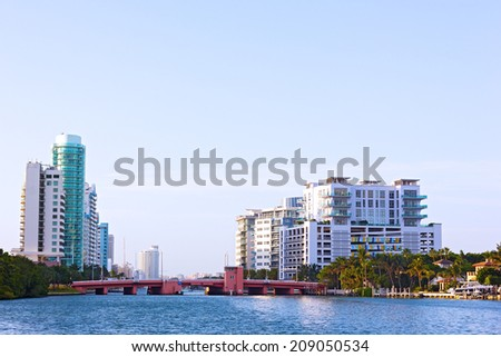 Bridge and residential buildings along the canal in Miami Beach, Florida. A spring morning in Miami Beach suburb.  - stock photo