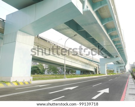 Bridge and roadway in city - stock photo