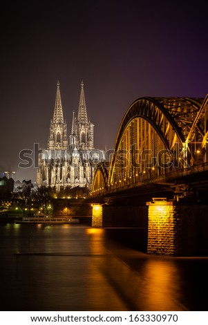 Bridge and the Dom of Cologne at night. Cologne, Germany - stock photo