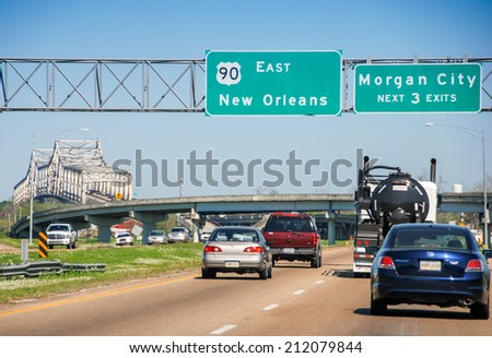 Bridge and traffic to New Orleans. - stock photo