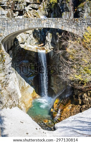 Bridge and Waterfall at Mount Rainier National Park - stock photo