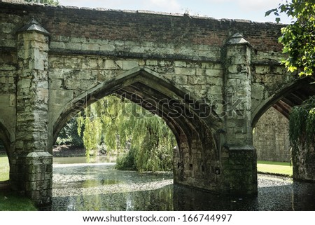 Bridge arch over river on a summers day