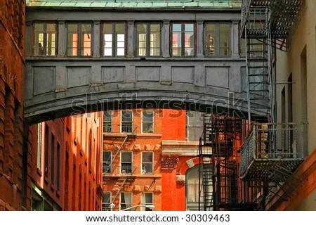 bridge between buildings - stock photo