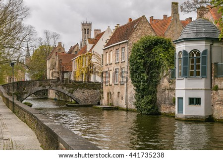 Bridge, canal and old houses in Brugge.
