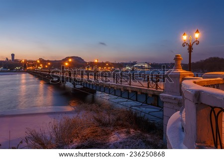 Bridge city landscape in snowy winter night , Ukraine, Donetsk - stock photo