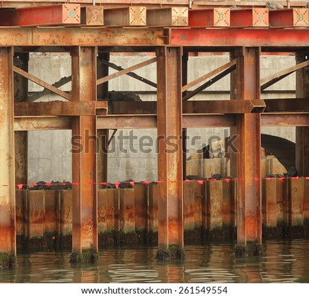 Bridge construction detail with massive steel girders anchored in the ground