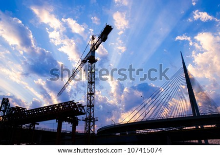 Bridge construction in the conta light - stock photo
