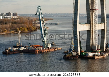Bridge construction site with tower cranes