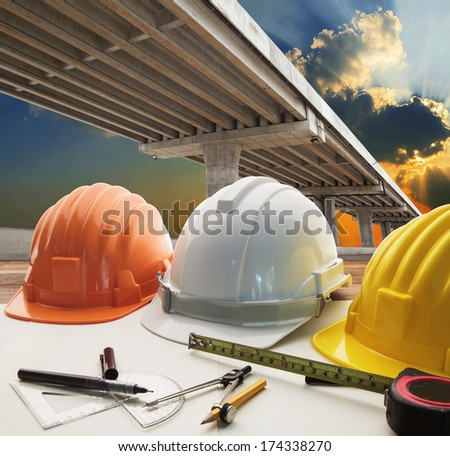 bridge crossing road junction and civil engineer working table use for urban infra structure and government  development topic and civil engineering ,real estate topic - stock photo