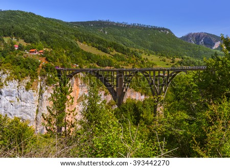Bridge Durdevica in River Tara canyon - Montenegro - travel background - stock photo