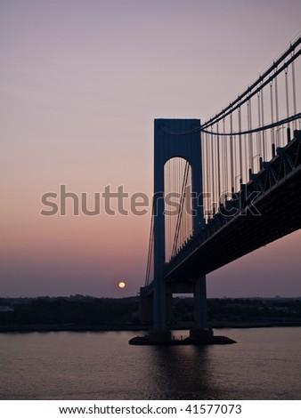 Bridge full of commuters at dawn - stock photo