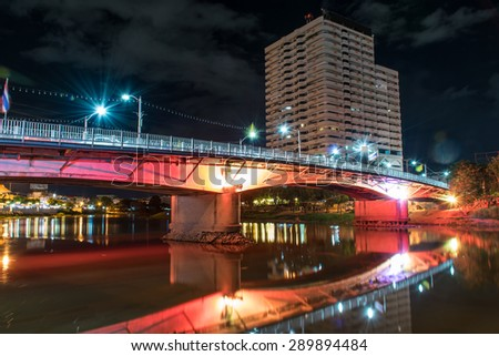 Bridge in Chiang Mai City at night with colorful light over river