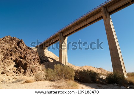 Bridge in the desert near the Large Crater (Makhtesh Gadol) in Israel's Negev desert - stock photo