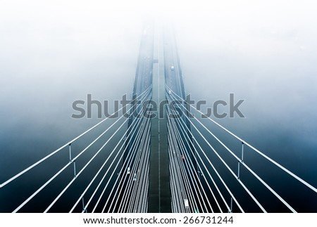 Bridge in the fog - stock photo